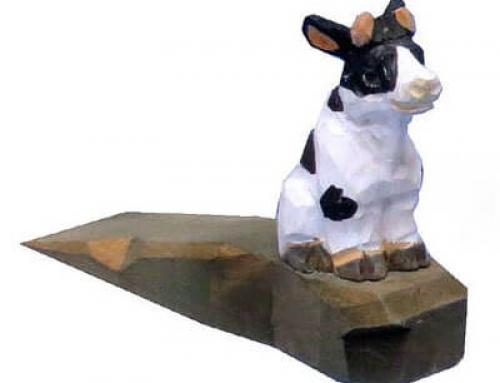 Hand carved wood cow door stopper