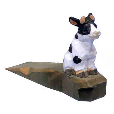 Hand carved wood cow door stopper