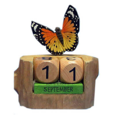 Hand carved wood perpetual calendar butterfly