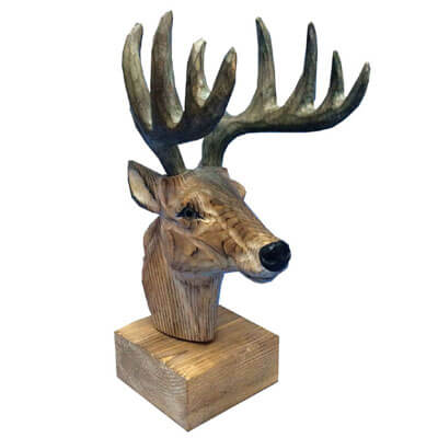 Hand carved wooden deer head