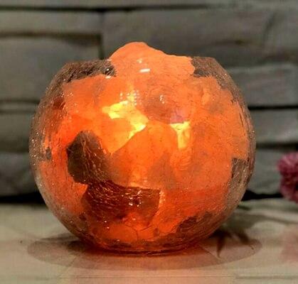 Himalayan crystal salt chunks in the glass bowl.