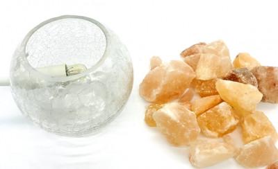 Himalayan salt chunks in the glass bowl.