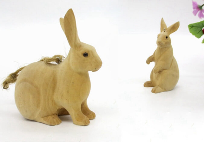 hand carved wood rabbits